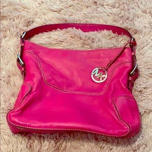 Hot pink Michael Kors bag.
